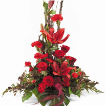 Traditional upright forward facing arrangement using a selection of seasonal flowers and foliages